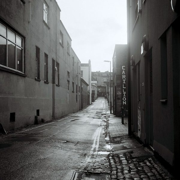 Medium Format black and white view of Hampton Lane on a sunny day without people (1:1 aspect ratio)
