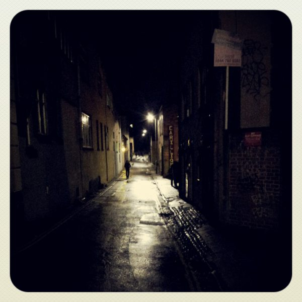 Night time vew of Hampton lane with a silhoutted individual