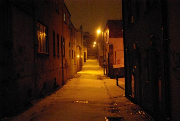 Colour photograph of Hampton Lane at night with fresh snow and amber street lighting