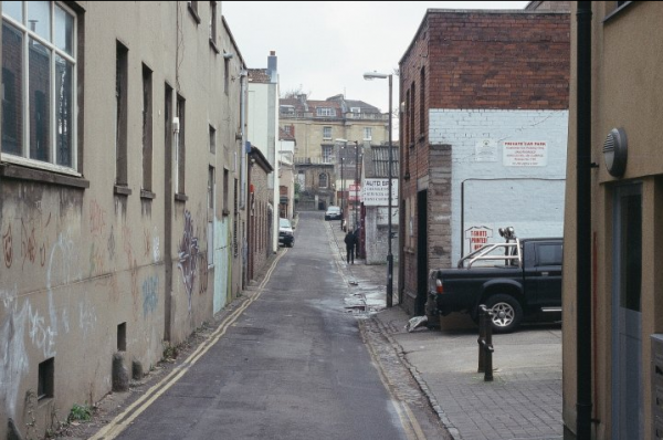 Colour photo of Hampton Lane on an overcast day with a lone individual in the middle distance.