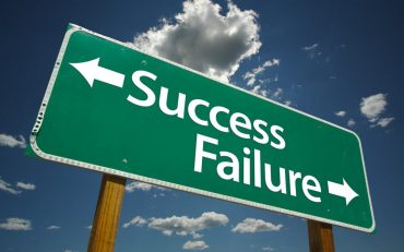 Road sign for sucess or failure